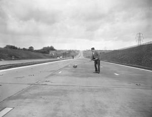 M1 motorway: 1959: A workman sweeps part of the new London-Yorkshire motorway