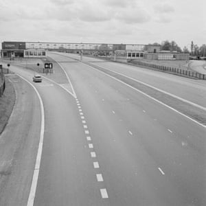 M1 motorway: 1960: A car turns off the empty M1 motorway to a Fortes Service Station