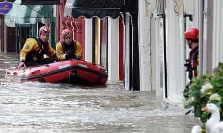 A flooded Cockermouth high street, in Cumbria