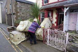 Cockermouth floods: Residents remove water damaged furniture from a house in Cockermouth