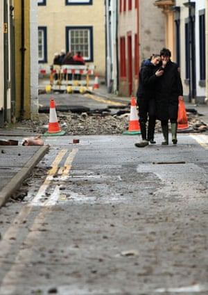 Cockermouth floods: Two women comfort each other as they return to their flood damaged home