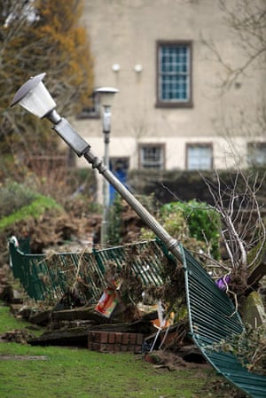 Cockermouth floods: A lamp is left at an angle as flood water recedes