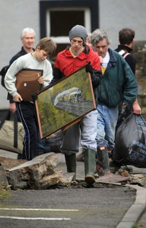 Cockermouth floods: Residents collect and pack up their belongings as they are evacuated