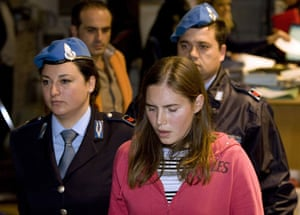 Meredith Kercher trial: Jailed suspect Amanda Knox reacts as she leaves a courtroom