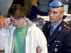 Meredith Kercher trial: Jailed suspect Raffaele Sollecito reacts as he leaves a courtroom