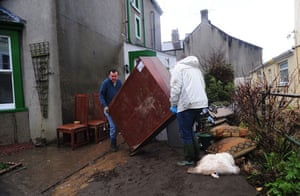 Cockermouth clear-up: Residents clear debris from their homes after flood water receded