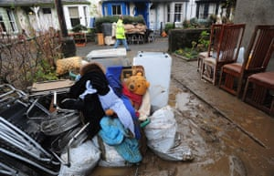 Cockermouth clear-up: Debris and flood damaged items outside homes in Cockermouth