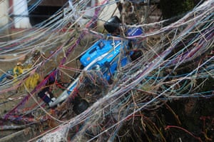 Cockermouth clear-up: A child's toy racing car is tangled with wool and other debris