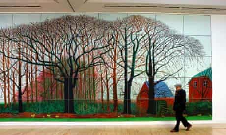 David Hockney at Tate Britain with one of the copies flanking Bigger Trees Near Warter (2007).