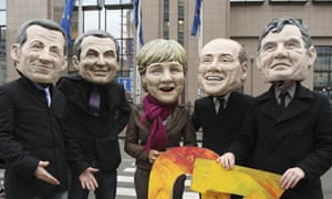 Climate protesters wearing masks of European leaders in Brussels on Monday