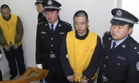 Zhang Yujun waiting to be put on trial in December 2008