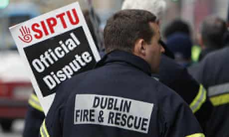 Members of Dublin's fire service on a picket line during a one-day nationwide strike in Ireland.