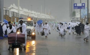 Mecca Hajj: Pilgrims attending the hajj walk on flooded streets during heavy rains