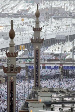Mecca Hajj: Pilgrims attending the hajj walk on flooded streets during rain in Mina