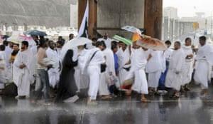 Mecca Hajj: Pilgrims attending the hajj shelter from heavy rains in Mecca, Saudi Arabia