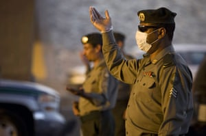 Mecca Hajj: Security officials keeps an eye on cars at a checkpoint