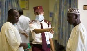 Mecca Hajj: A security guard directs Muslim pilgrims seeking medical care