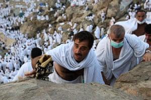 Mecca Hajj: Muslim pilgrims climb the Mountain of Mercy, near Mecca, Saudi Arabia