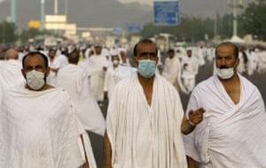 Mecca Hajj: Muslim pilgrims wearing protective masks walk towards Mount Mercy