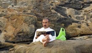 Mecca Hajj: A Muslim pilgrim reads the Koran on Mount Mercy