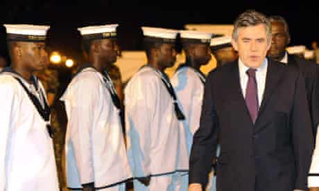 Gordon Brown arrives at Port of Spain in Trinidad for the Commonwealth meeting on 26 November 2009.