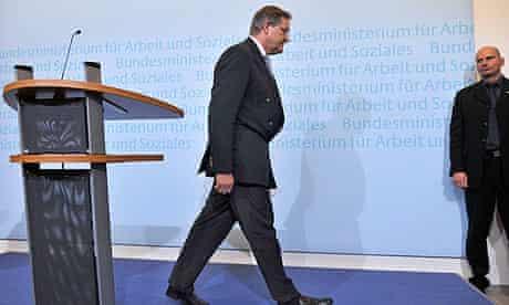Former German defence minister Franz Josef Jung, leaves the podium after resigning in Berlin.