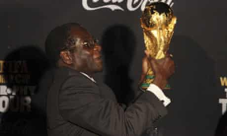 Robert Mugabe with the World Cup 26/11/09