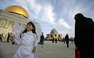 Eid al-Adha: A Palestinian girl dressed in costume