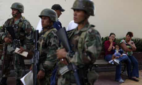 Soldiers stand guard outside the Honduras congress