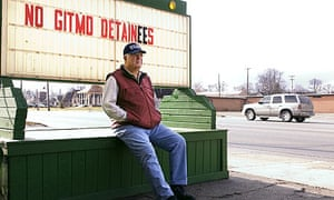 Dave Munson by the sign outside his Standish restaurant