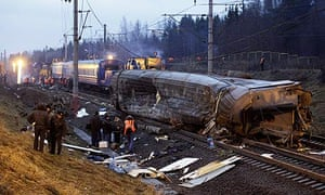 Russian investigators and rescue workers at the site of the train crash near Uglovka