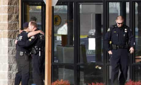 Police officers outside the Forza coffee shop in Lakewood, WA