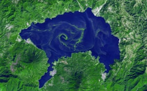 Satellite Eye on Earth: Guatemala's Lake Atitlan with bloom of cyanobacteria, blue-green algae