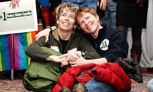 Gay marriage supporters Susan McCray (l) and Yvette Pratt watch election results in Portland, Maine.