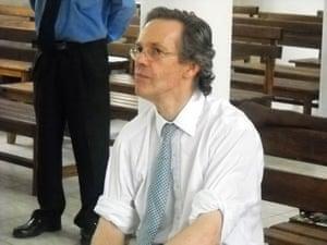 Simon Mann: Simon Mann listening to the pardon ceremony in Malabo