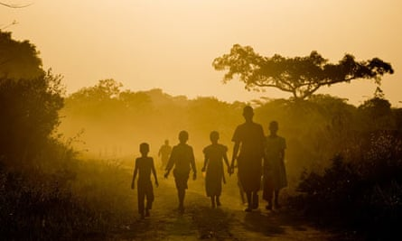 Children play during sunset at Ogwolo village, Katine