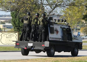 fort hood shooting: A swat team enters the main gate at Fort Hood