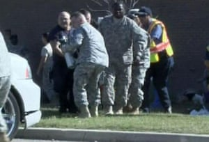 fort hood shooting: emergency personnel carrying wounded at the U.S. Army post at Fort Hood