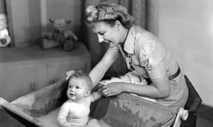 Woman bathing a baby, 1948