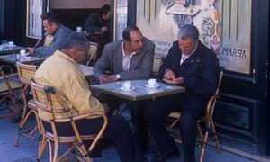 Men having coffee at sidewalk cafe, Isle Sur la Sorgue, Provence, France
