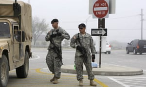 Soldiers guard the entrance to Fort Hood military base in Texas