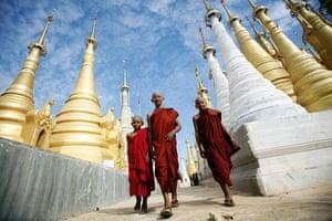 Eyewitness: Buddhist monks walk through Shwe Indein Pagoda near Inle lake