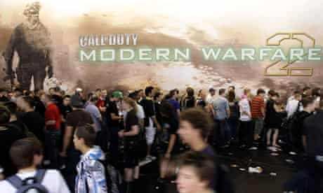 Visitors walk past an exhibition stand for Call of Duty: Modern Warfare 2 at the Gamescom 2009 fair