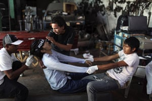 Guatemala morticians: Men prepare their brother for his funeral in Guatemala City