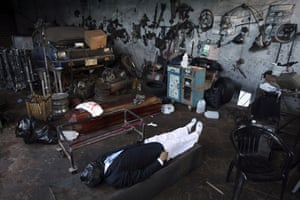 Guatemala morticians: The body of a man who was murdered lies in the Valle del Sol funeral home