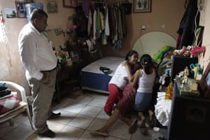 Guatemala morticians: A funeral salesman watches women cry over the body of a murdered relative