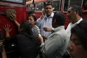 Guatemala morticians: Funeral salesmen try to sell funeral packages to relatives of a shot man