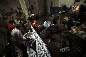 Guatemala morticians: Morticians prepare a corpse for a funeral in the Valle del Sol funeral home