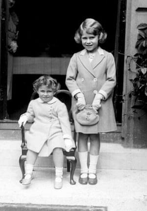 Queen Elizabeth II: 1933: Princess Elizabeth stands next to her sister Princess Margaret