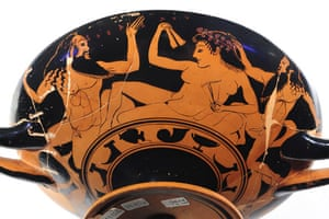 eros exhibition: Attic depicting a banquet scene among two Satyrs and a naked Maenad